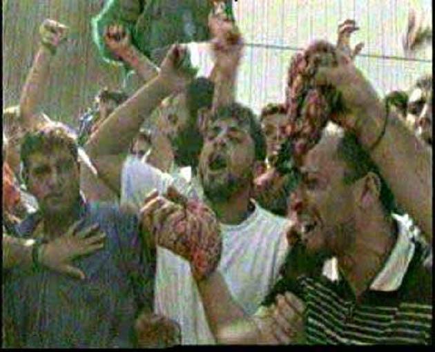 Arabs%20waving%20entrails%20of%20butchered%20Israelis%20in%20Ramallah.jpg