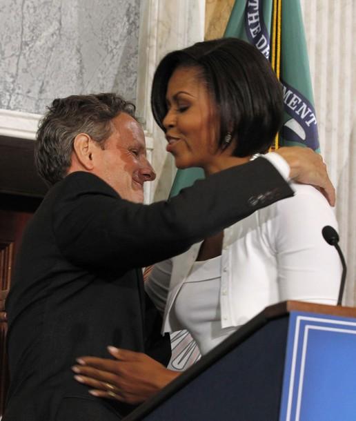 Geithner%20hugs%20Michelle.jpg
